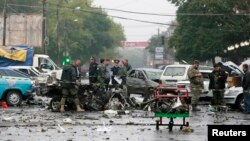 Investigators work at a suicide bomb blast site in Vladikavkaz in Russia's restive North Caucasus, Sep. 10, 2010.