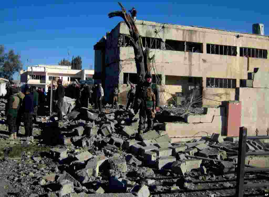 Security forces inspect the local headquarters of the Kurdistan Democratic Party after a bomb attack in Kirkuk, Iraq, January 16, 2013.
