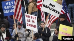People gather to protest against the United States' acceptance of Syrian refugees at the Washington State capitol in Olympia, Washington, Nov. 20, 2015. Similar lawsuits to that of Indiana's are also pending in Pennsylvania, Texas and Alabama.