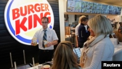 Burger King memperbesar jaringan di Kanada dengan membeli jaringan pengecer 'Tim Horton' (foto: dok).