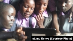 Children in Kenya using eLimu tablet to access educational software.
