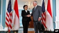 FILE - Secretary of State Rex Tillerson shakes hands with Indonesian Foreign Minister Retno Marsudi, May 4, 2017, at the State Department in Washington.