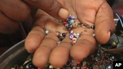 An entrepreneur sorts beads in Haiti.