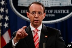 FILE - Deputy Attorney General Rod Rosenstein speaks during a news conference at the Department of Justice.