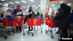 FILE - People shop inside a Target store during Black Friday sales in the Brooklyn borough of New York, Nov. 29, 2013.