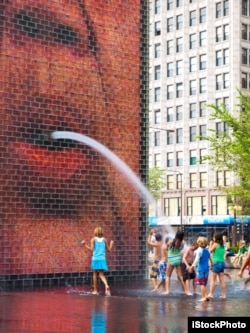 Chicago USA - August 24, 2010: Children playing in the Crown Fountain at Millenium Park