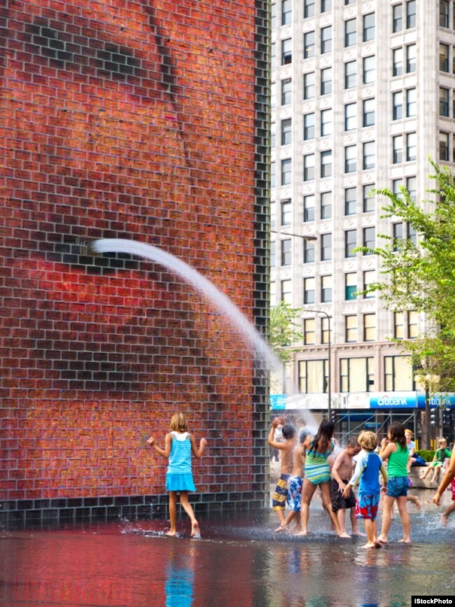 Children play in the Crown Fountain at Chicago's Millenium Park, 2010.