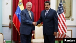 Venezuela's President Nicolas Maduro shakes hands with U.S. diplomat Thomas Shannon during their meeting at Miraflores Palace in Caracas, Venezuela, June 22, 2016.