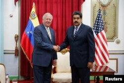 Venezuela's President Nicolas Maduro shakes hands with U.S. diplomat Thomas Shannon during their meeting at Miraflores Palace in Caracas, Venezuela, June 22, 2016.