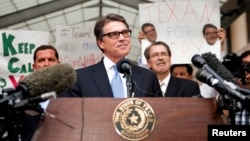 Texas Governor Rick Perry speaks after being booked at the Travis County courthouse in Austin, Aug. 19, 2014.