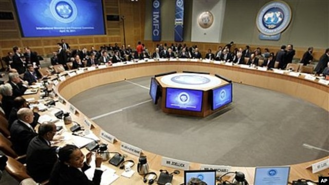 Delegates of the International Monetary and Financial Committee (IMFC) gather at the spring meetings of the IMF/World Bank in Washington, April 16, 2011
