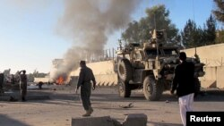 FILE - Smoke bellows after a suicide car bomb blast attacked a military convoy in Lashkar Gah, Helmand province, Afghanistan, Nov. 15, 2015.