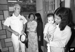 John McCain visits the Holt orphanage in Saigon, Vietnam, on Oct. 30, 1974.
