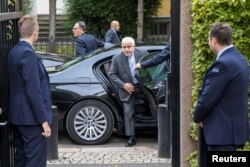Iran's Foreign Minister Javad Zarif is surrounded by bodyguards as he arrives for a meeting in Oslo, Norway, Aug. 22, 2019.