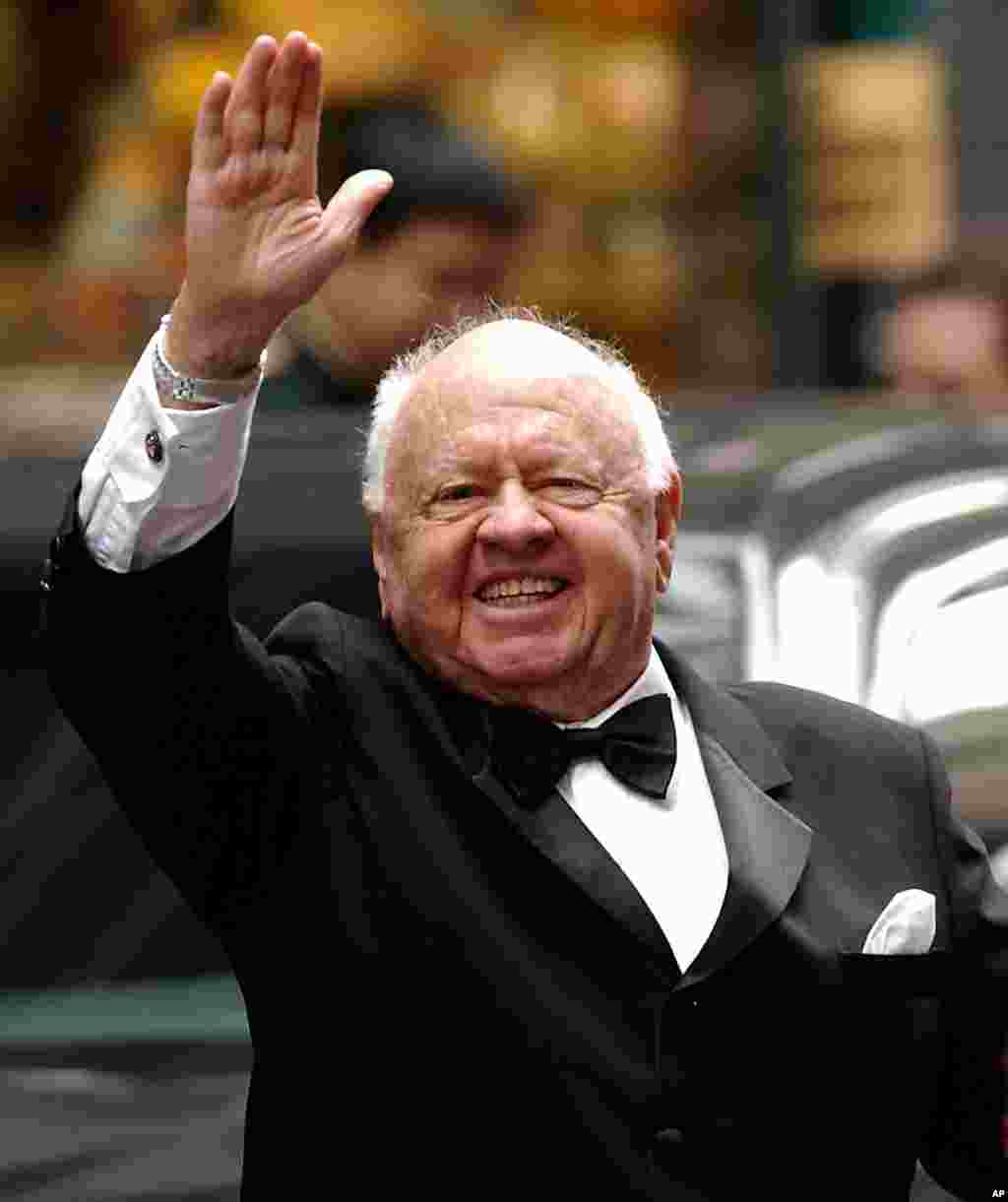 Actor Mickey Rooney waves to admirers as he departs the Regent Wall Street Hotel in New York. He was Hollywood's top box-office draw in the late 1930s-1940s. He died Sunday, April 6, 2014, at his North Hollywood home at age 93.