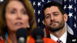 House Speaker Paul Ryan of Wis. listens as House Minority Leader Nancy Pelosi of Calif. speaks on Capitol Hill in Washington, Dec. 9, 2015, before Ryan signed legislation that changes how the nation's public schools are evaluated, rewriting the landmark No Child Left Behind education law of 2002.