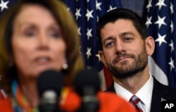 FILE - House Speaker Paul Ryan of Wis. listens as House Minority Leader Nancy Pelosi of Calif. speaks on Capitol Hill in Washington, Dec. 9, 2015, before Ryan signed legislation that changes how the nation's public schools are evaluated, rewriting the landmark N