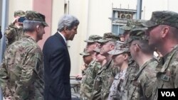 "FILE - Secretary of State Kerry greets U.S. troops outside Resolute Support Headquarters following a meeting with General ""Mick"" Nicholson, commander of U.S. forces in Afghanistan, April 9, 2016. (P. Dockins/VOA)"