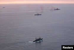 A photo taken from a Norwegian surveillance aircraft shows a group of Russian navy ships in international waters off the coast of northern Norway, Oct. 17, 2016.