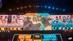 In this Friday, July 27, 2018 photo, fans watch the Philadelphia Fusion and London Spitfire compete in the Overwatch League Grand Finals' first night of competition at the Barclays Center in the Brooklyn borough of New York. (AP Photo/Terrin Waack)