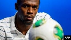 Le Jamaïcain Usain Bolt lors d'une conférence de presse au siège social de la Fifa, Zurich, le 28 août 2013.