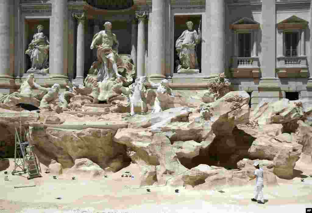 Workers clean the inside of the Trevi fountain during a one-day routine maintenance, in Rome, Italy.
