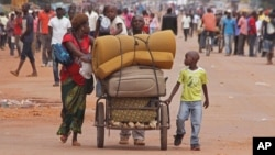 FILE - A family with its belongings on a makeshift cart is seen in Bangui, Central African Republic, Sept. 30, 2015. Many residents are fleeing sectarian clashes between rivaling Christian and Muslim militias.