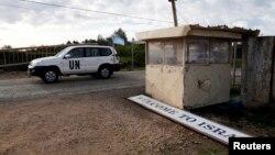 8일 유엔 평화유지군 차량이 골란 고원의 이스라엘 지역에서 휴전선 너머 시리아로 향하고 있다.