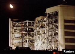 An April 21, 1995 file photo shows the moon over the wreckage of the Alfred P. Murrah Federal Building in downtown Oklahoma City, Oklahoma.