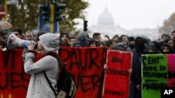 Italian students protest against the government-proposed education reforms, which are being voted in the Italian parliament, in Rome, 30 Nov 2010