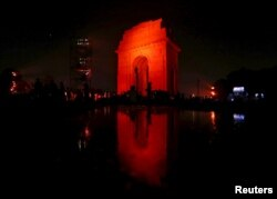 The India Gate war memorial was illuminated in orange Wednesday to commemorate the International Day for the Elimination of Violence Against Women, in New Delhi, India, Nov. 25, 2015.