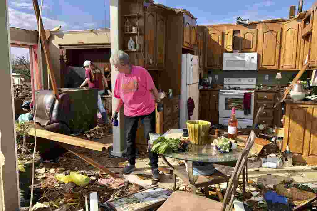 Patti Herring cries as she looks at the ruins of her home in Fultondale, Alabama, after it was destroyed by a powerful tornado.