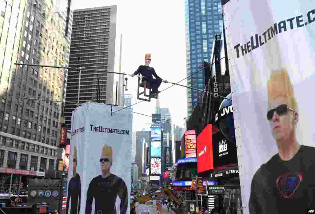 International circus superstar Bello Nock takes over Times Square in New York City spending eight hours on a high wire.