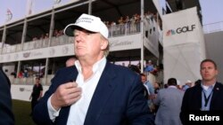 FILE - Republican presidential hopeful Donald Trump walks onto the 18th green for the awards ceremony following the final round at TPC Blue Monster at Trump National Doral earlier this year.