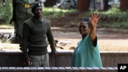 FILE: Prominent human rights lawyer Beatrice Mtetwa in prison clothes is being escorted to a Harare detention center.