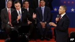President Barack Obama (R) and Republican presidential candidate Mitt Romney spar in their second debate in Hempstead, NY, October 16, 2012.