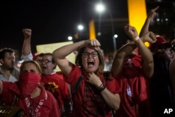 Supporters of President Dilma Rousseff shout during clashes with the police outside Congress, in Brasilia, Brazil, May 11, 2016.