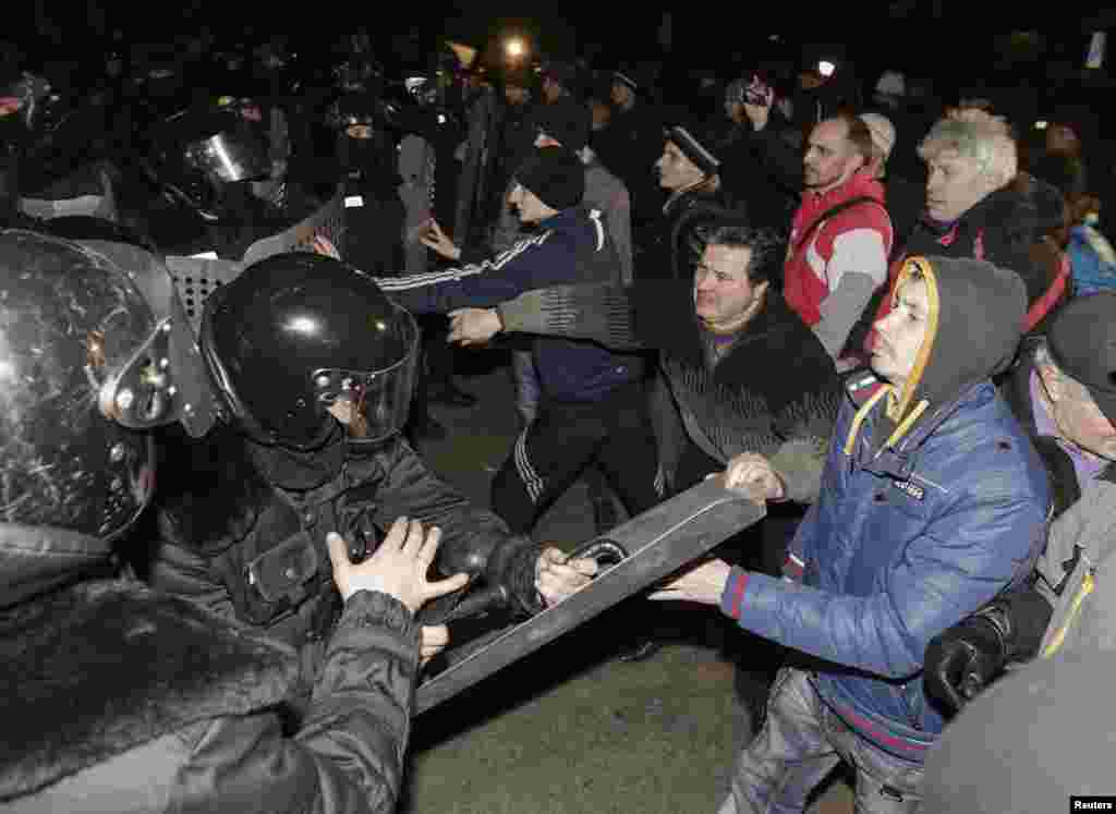 Pro-Russian demonstrators clash with riot police during a protest rally in Donetsk, Ukraine, March 6, 2014.