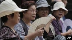 Women rest at a shrine in Tokyo, Japan. (AP Photo/Itsuo Inouye)