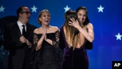 """Gal Gadot and Patty Jenkins embrace as """"Wonder Woman"""" wins the award for best action movie at the 23rd annual Critics' Choice Awards at the Barker Hangar on Jan. 11, 2018, in Santa Monica, California."""