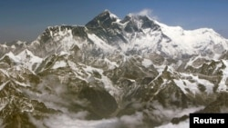 FILE - An aerial view shows the Himalayan mountain range along the border of Nepal and Tibet. Mount Everest, the tallest in the range, is also the world's tallest mountain with an altitude of 8,848 meters (29,028 feet), March 25, 2008.