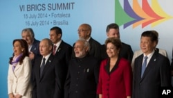 Leaders of the BRICS and South American nations pose for a group photo at the BRICS summit in Brasilia, Brazil, July 16, 2014.
