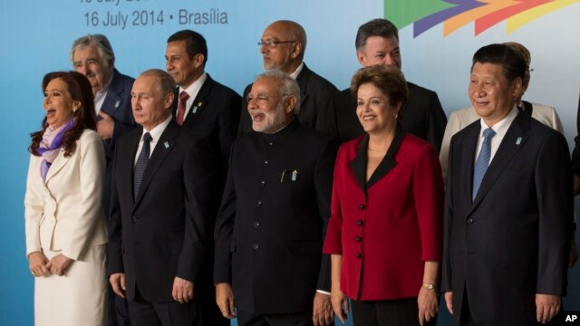 FILE - Leaders of the BRICS and South American nations pose for a group photo at the BRICS summit at Itamaraty palace in Brasilia, Brazil, July 16, 2014.