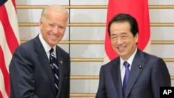 U.S. Vice President Joe Biden, left, is greeted by Japanese Prime Minister Naoto Kan prior to their meeting at Kan's official residence in Tokyo, Aug. 23, 2011