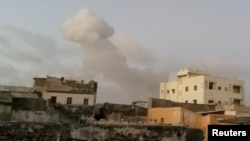 Smoke rises after car bombs explode in Mogadishu, Somalia, Feb. 23, 2018, in this still image taken from social media video.
