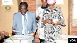 President Robert Mugabe voting in Harare's Highfield suburb Wednesday with his wife, Grace, and daughter Bona.