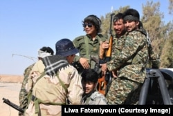 FILE - Fatemiyoun Afghan fighters in Syria