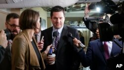 House Intelligence Committee Chairman Rep. Devin Nunes, R-Calif. is pursued by reporters as he arrives on Capitol Hill in Washington, March 28, 2017.