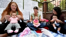 Parents and their infant children enjoy a music appreciation and therapy lesson held by parent Randi Madrid at her home in the Queens borough of New York, Monday, Oct. 12, 2008. (AP Photo/Craig Ruttle)