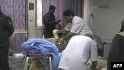 Assistência a vítimas de ataques em Bagdad (foto de arquivo)